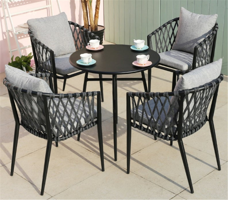 Set of 4 rattan chairs with small table  for patio decor.
