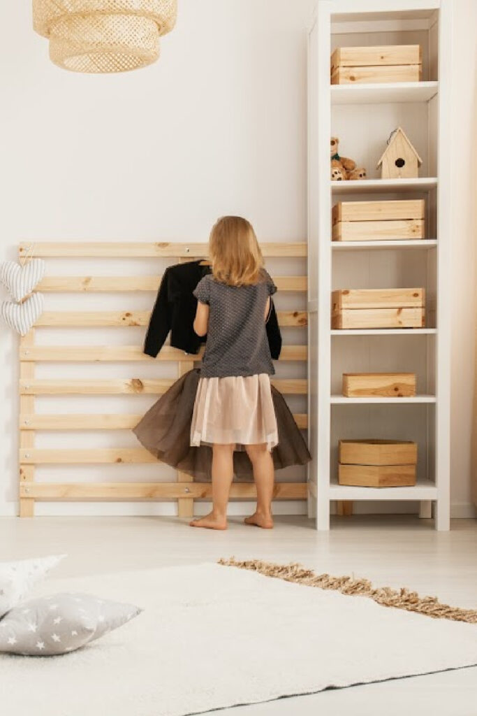Small wooden crate organizer for kids room.  white rack with wooden boxes