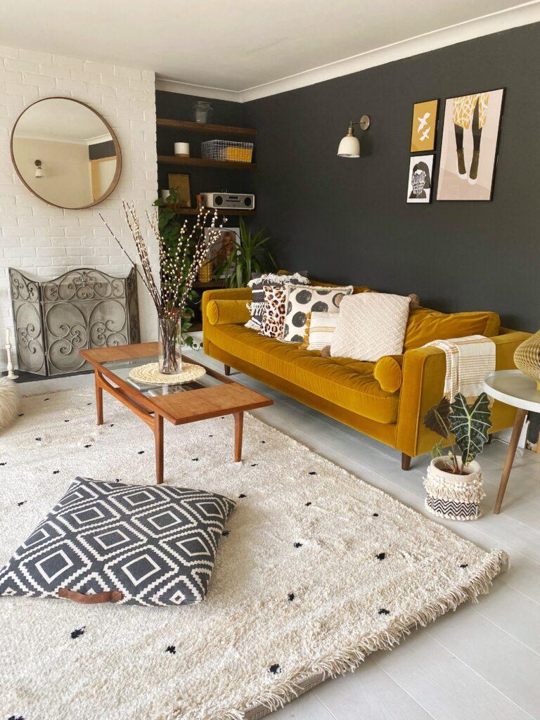 Trendy living room interior decor with mustard velvet couch