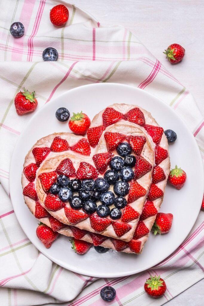 Valentines Day Heart shape tart with fresh strawberries & blueberries