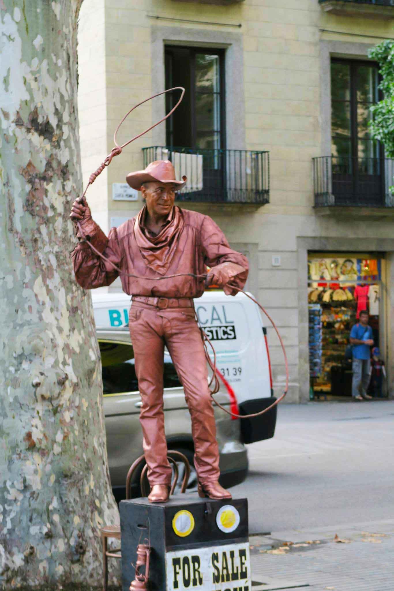 cowboy statue in La Rambla in Barcelona, Spain