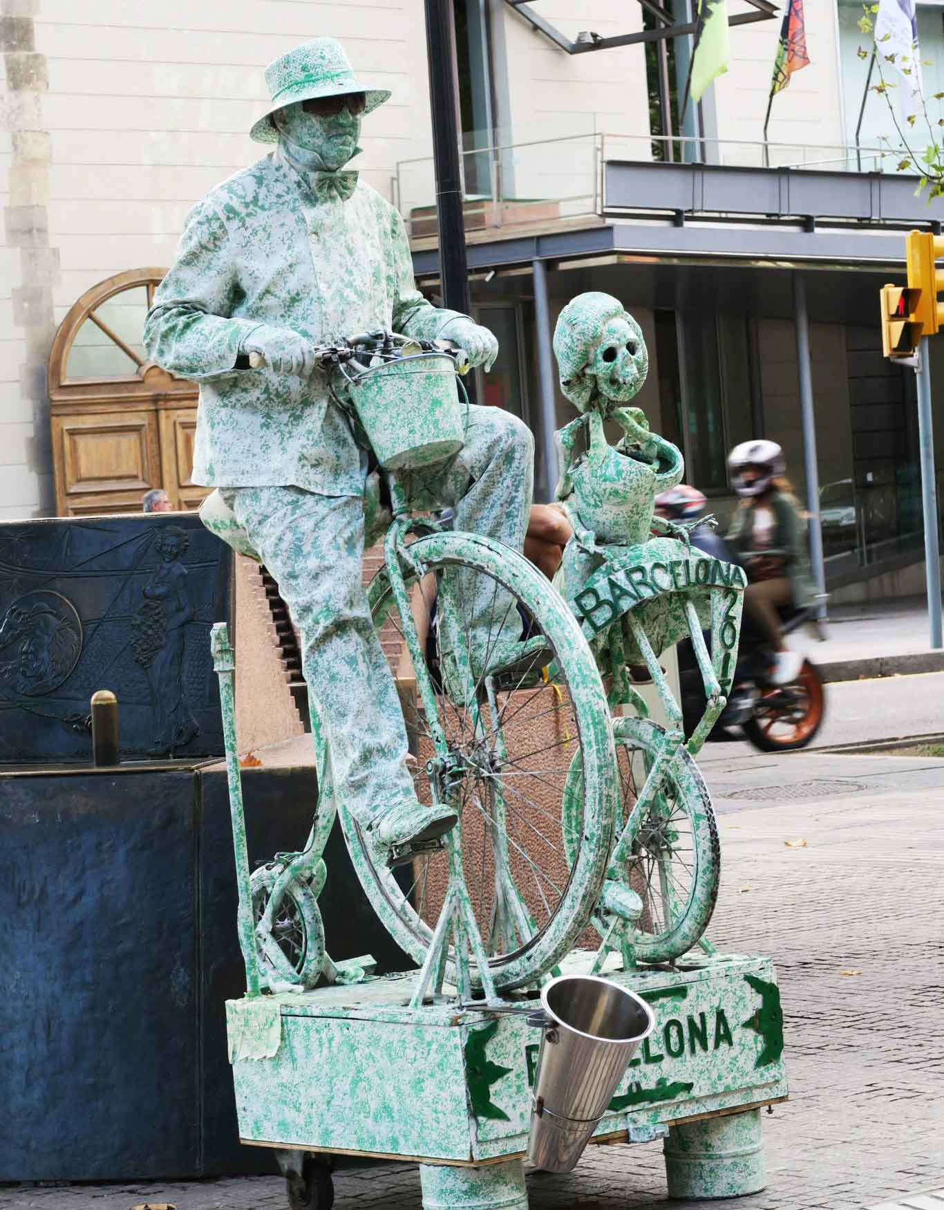 skeleton statue riding a bike in Las Ramblas, Barcelona, Spain