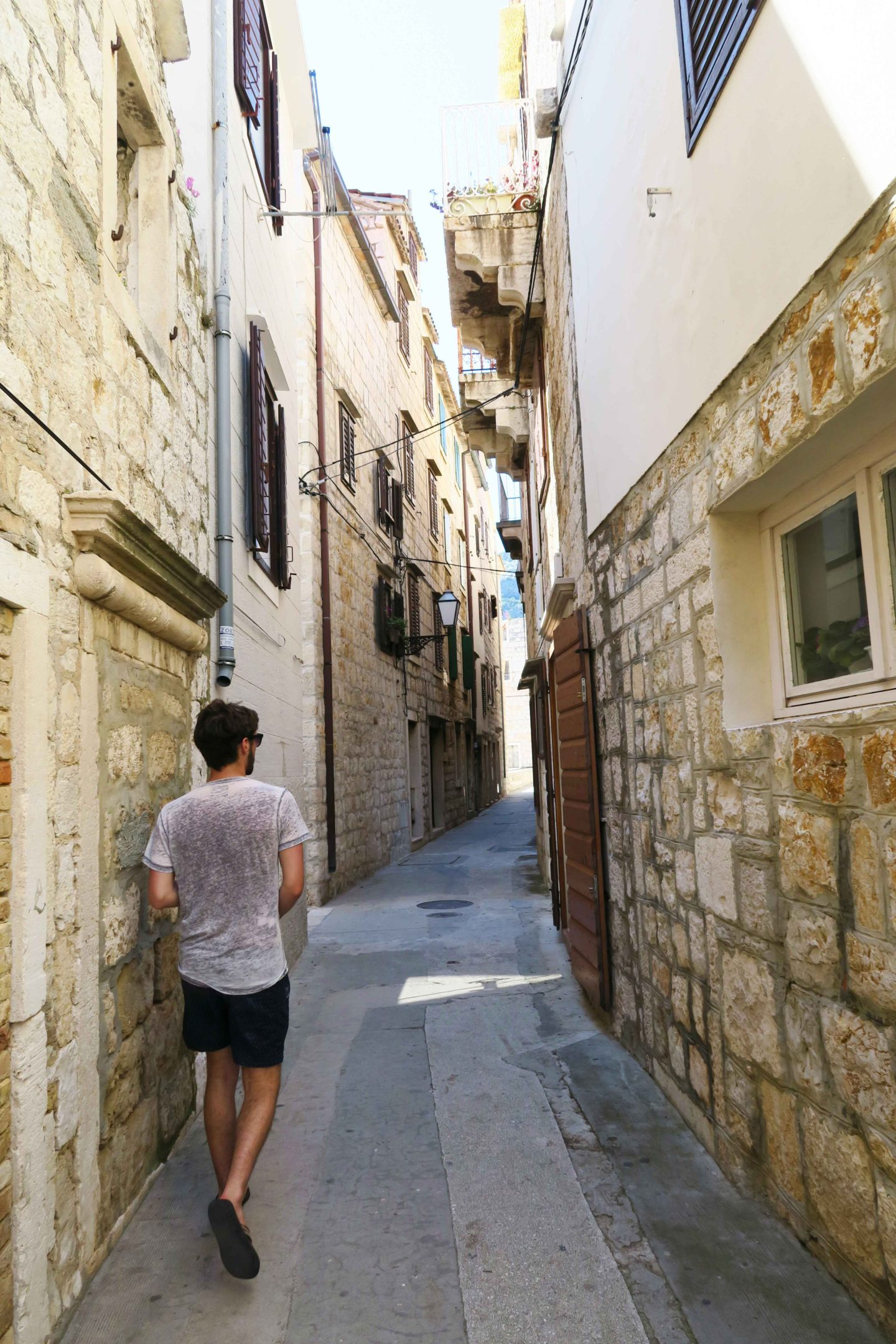 Sam Gill walking the streets of Komiza town in Vis, Croatia