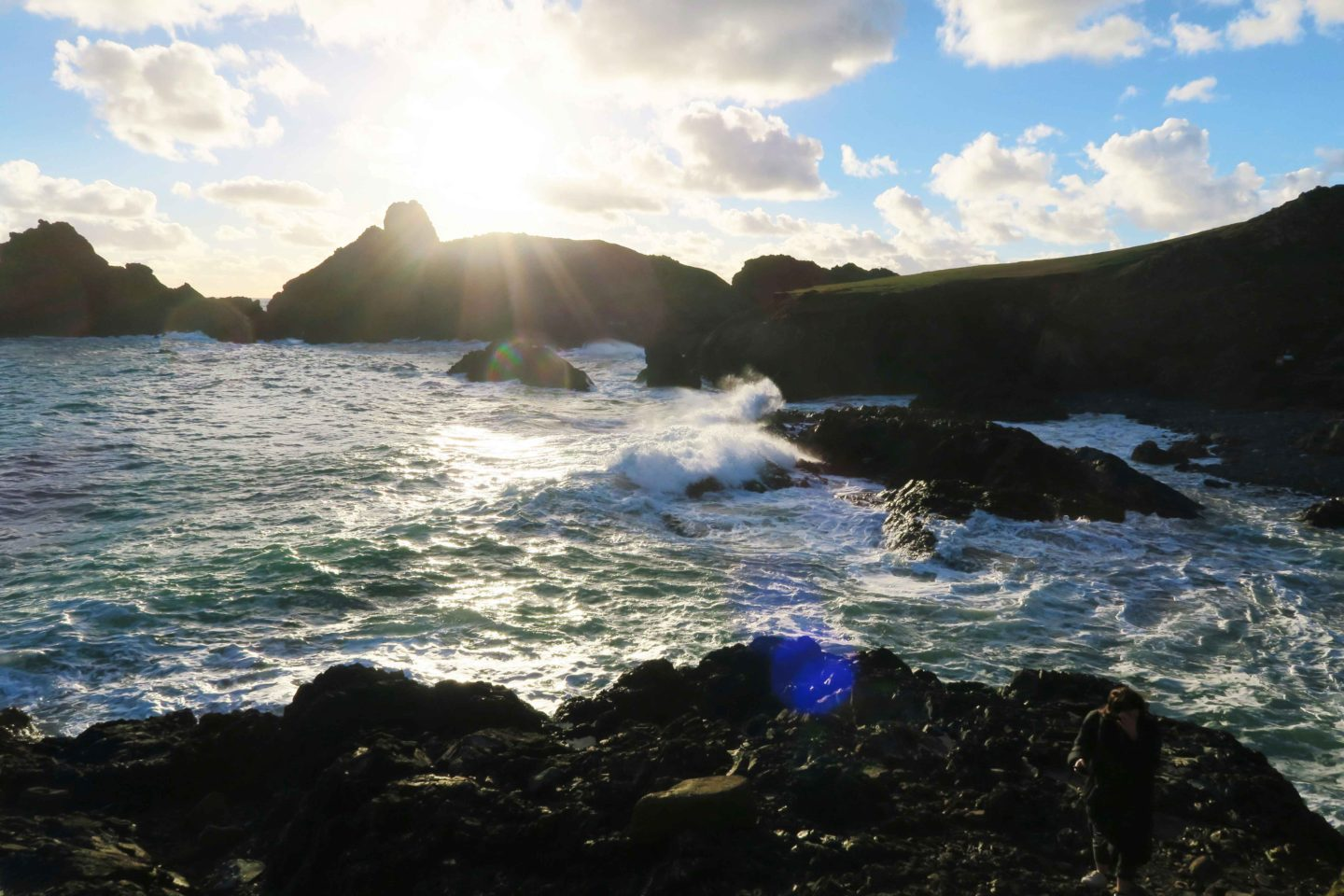 kynance cove on a stormy high tide day in cornwall