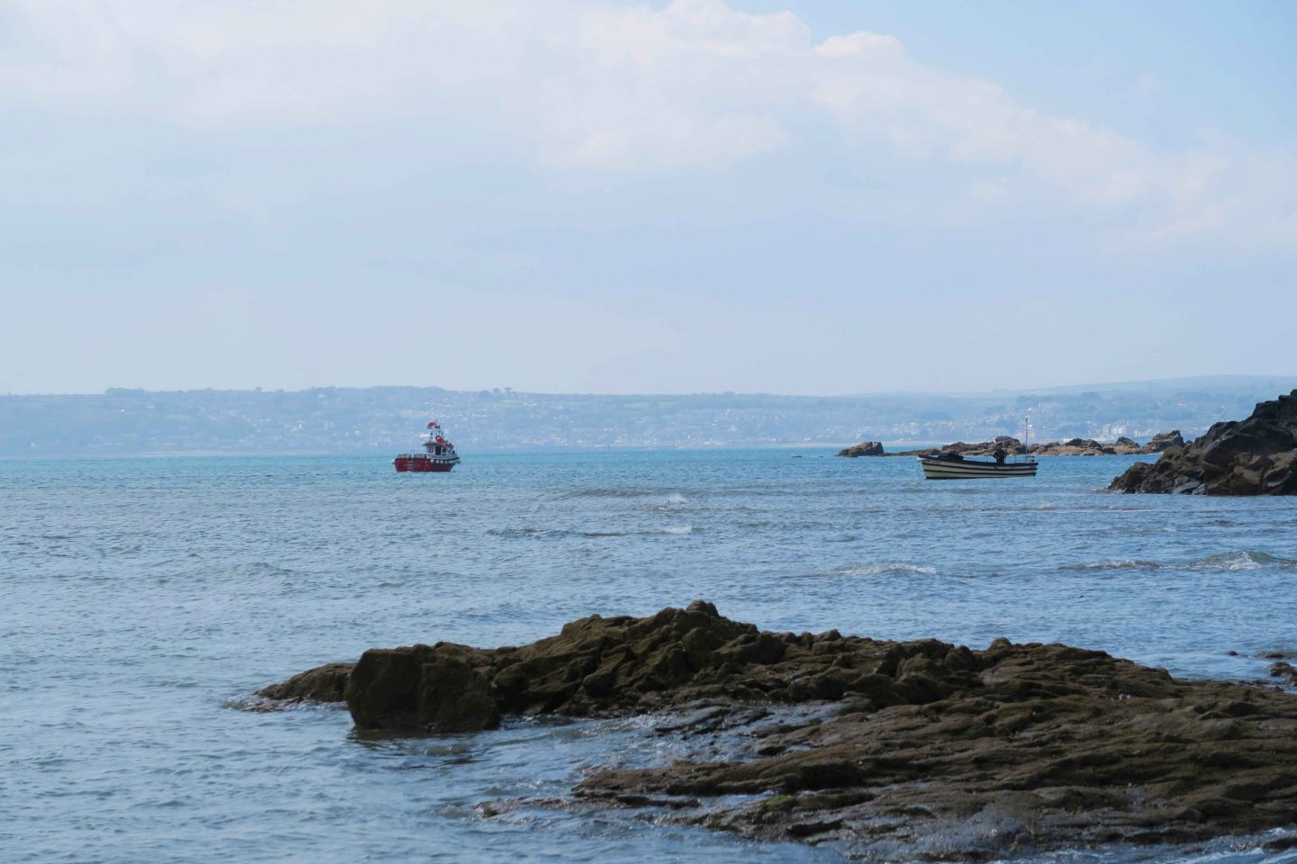 boats in the sea by marazion in cornwall