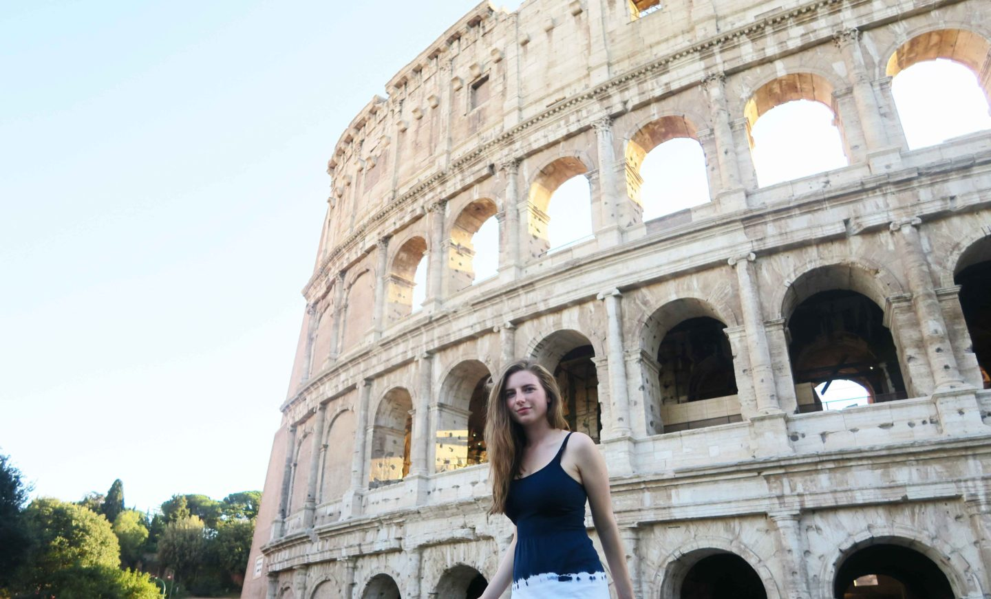 melissa carne standing in front of the colosseum in rome in italy