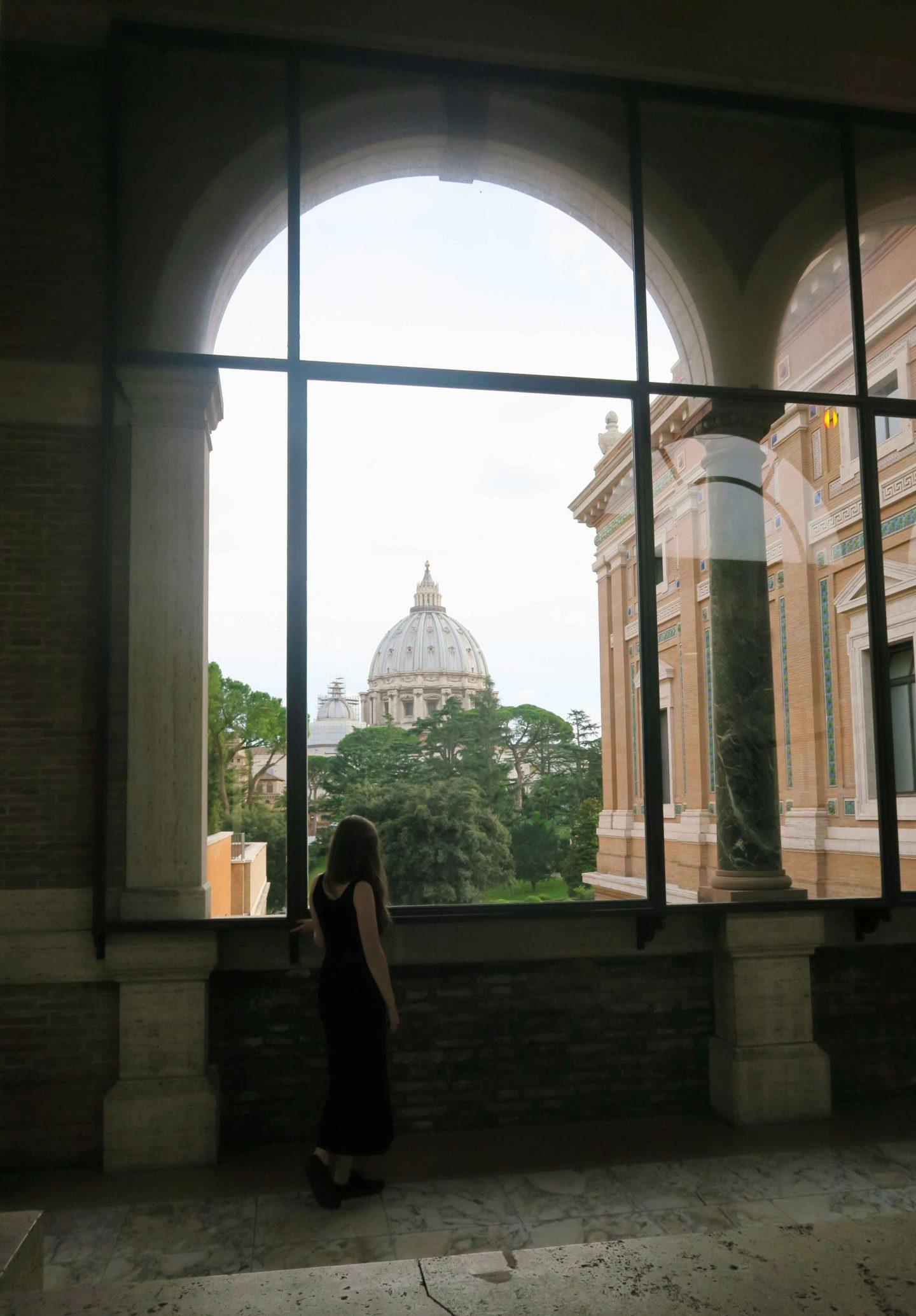 vatican museum window looking at the vatican in rome