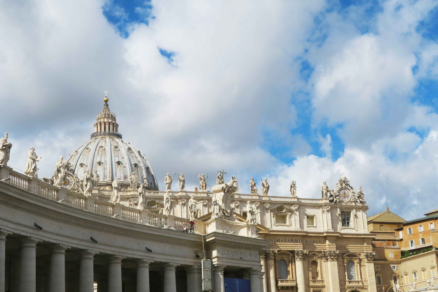 statues on top of the vatican entrance