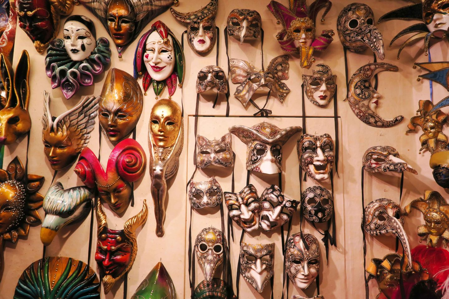 venitian masks on wall in gift shop in venice in italy