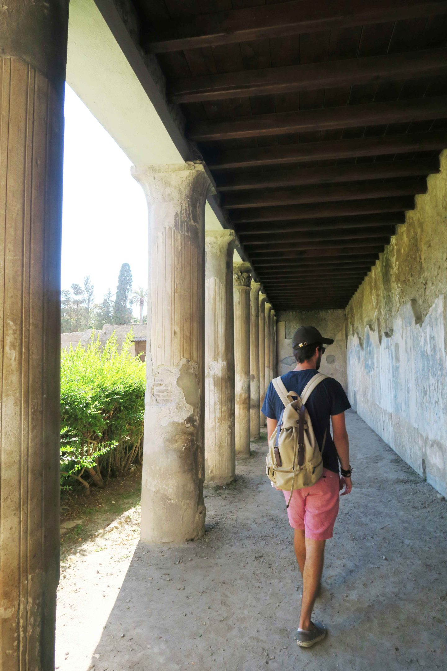 Sam Gill walking in ruins at Herculaneum archeological site in italy