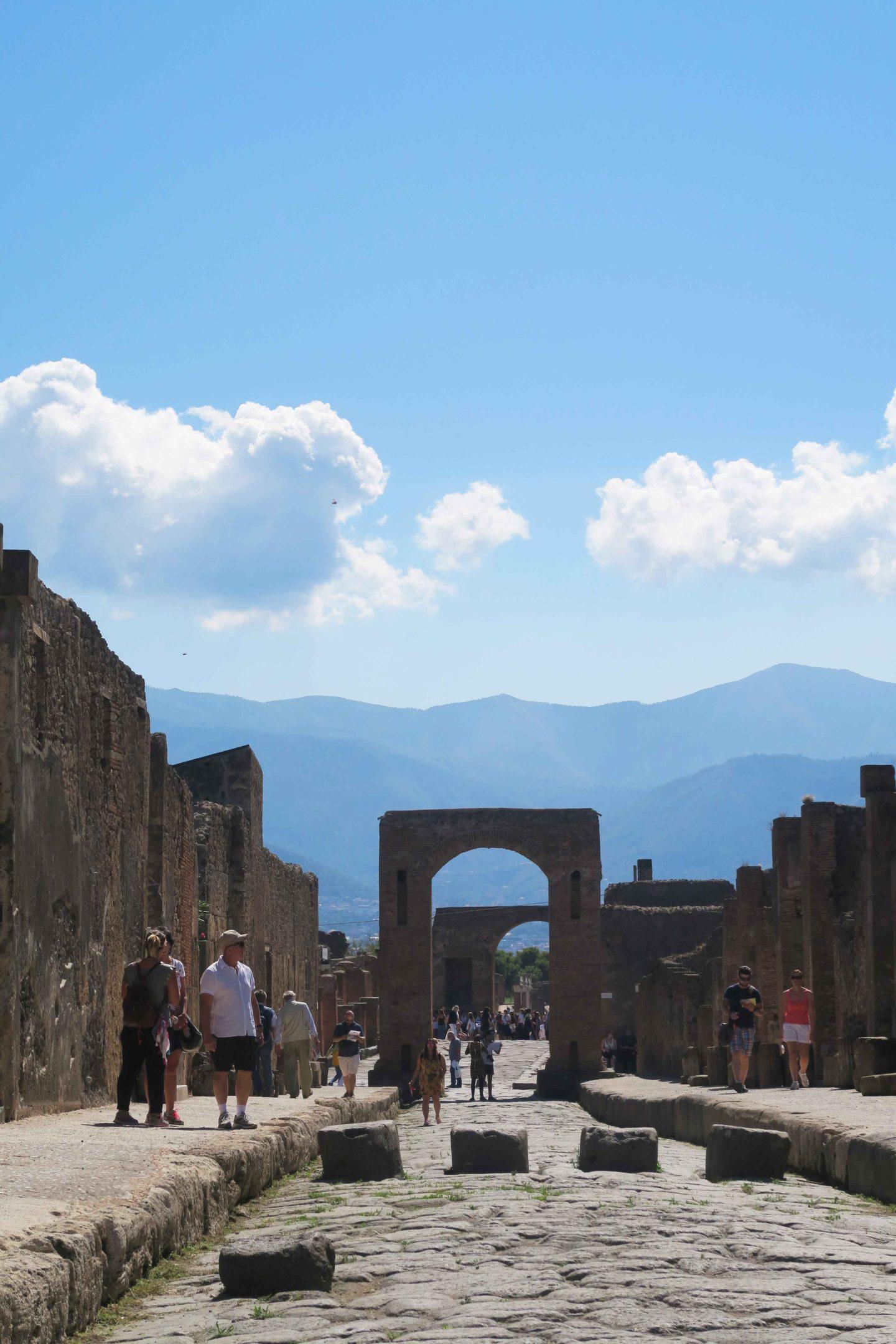 pompeii archway with mount vesuvius