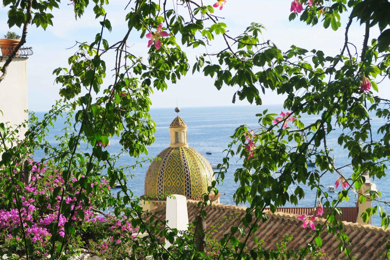 positano Church of Santa Maria Assunta with pink flowers