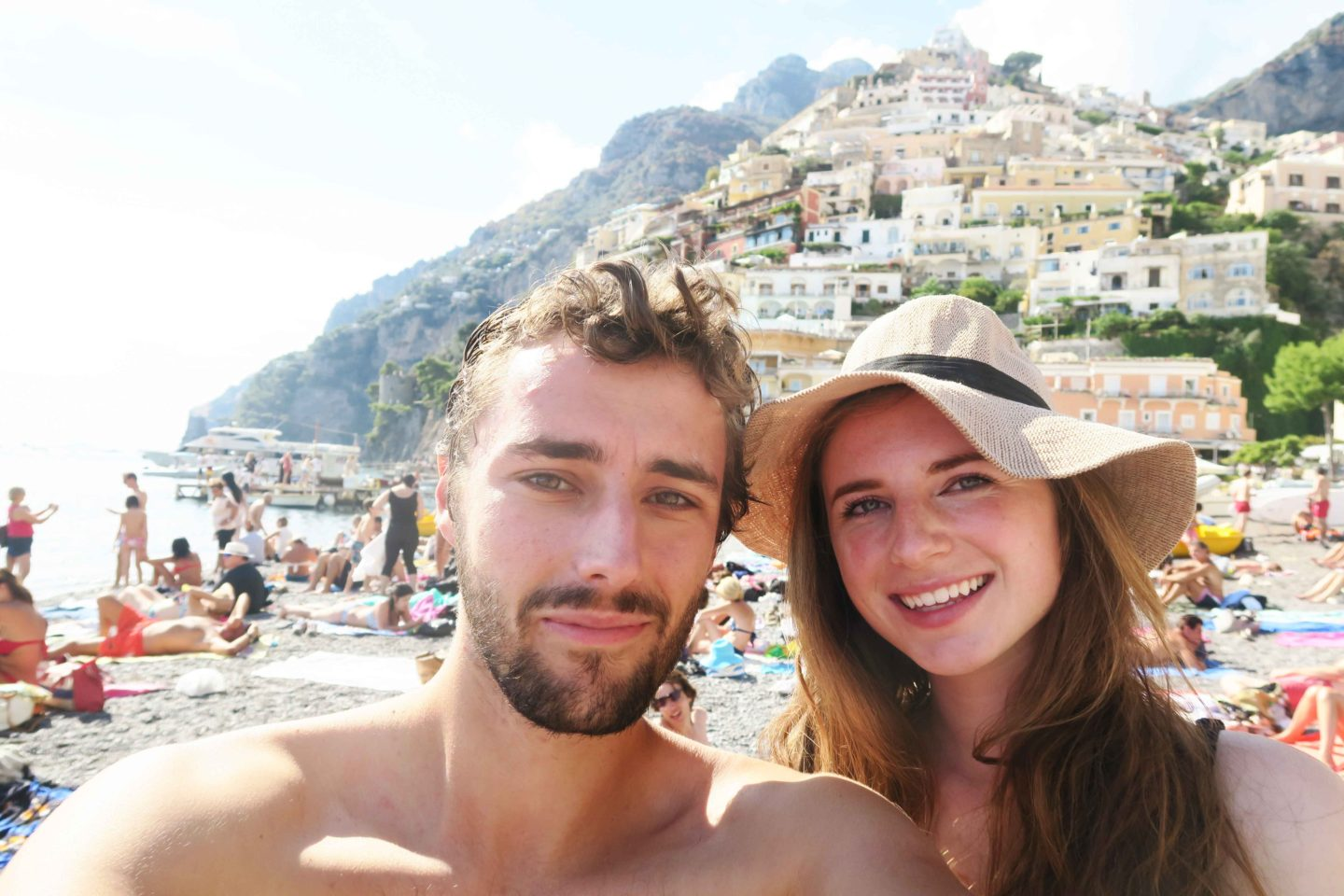 melissa carne and sam gill on the beach in positano on the almafi coast