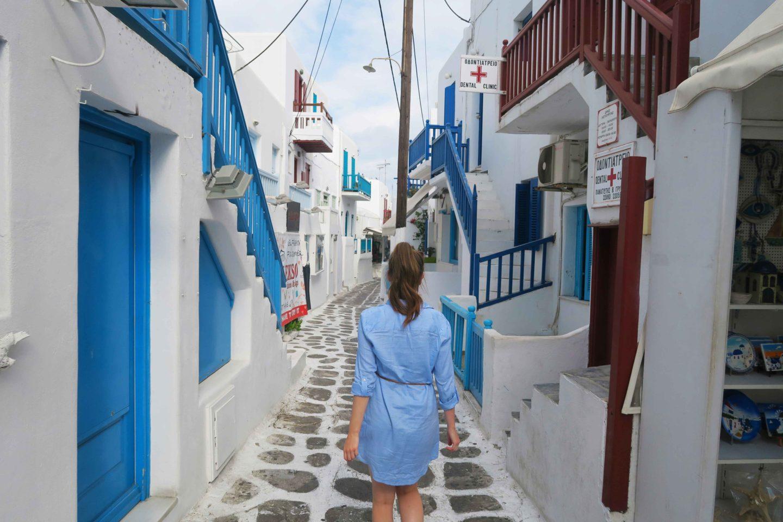 melissa carne wearing blue and walking down street in mykonos town