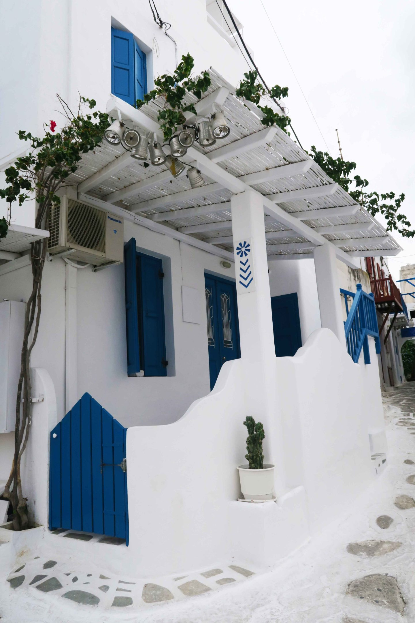 greek white and blue house on the corner of mykonos town
