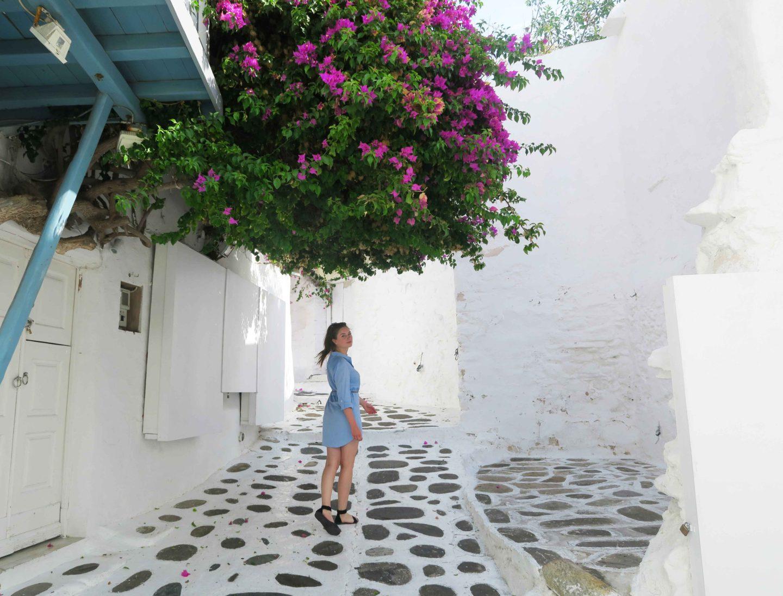 melissa carne walking in mykonos town under pink flower