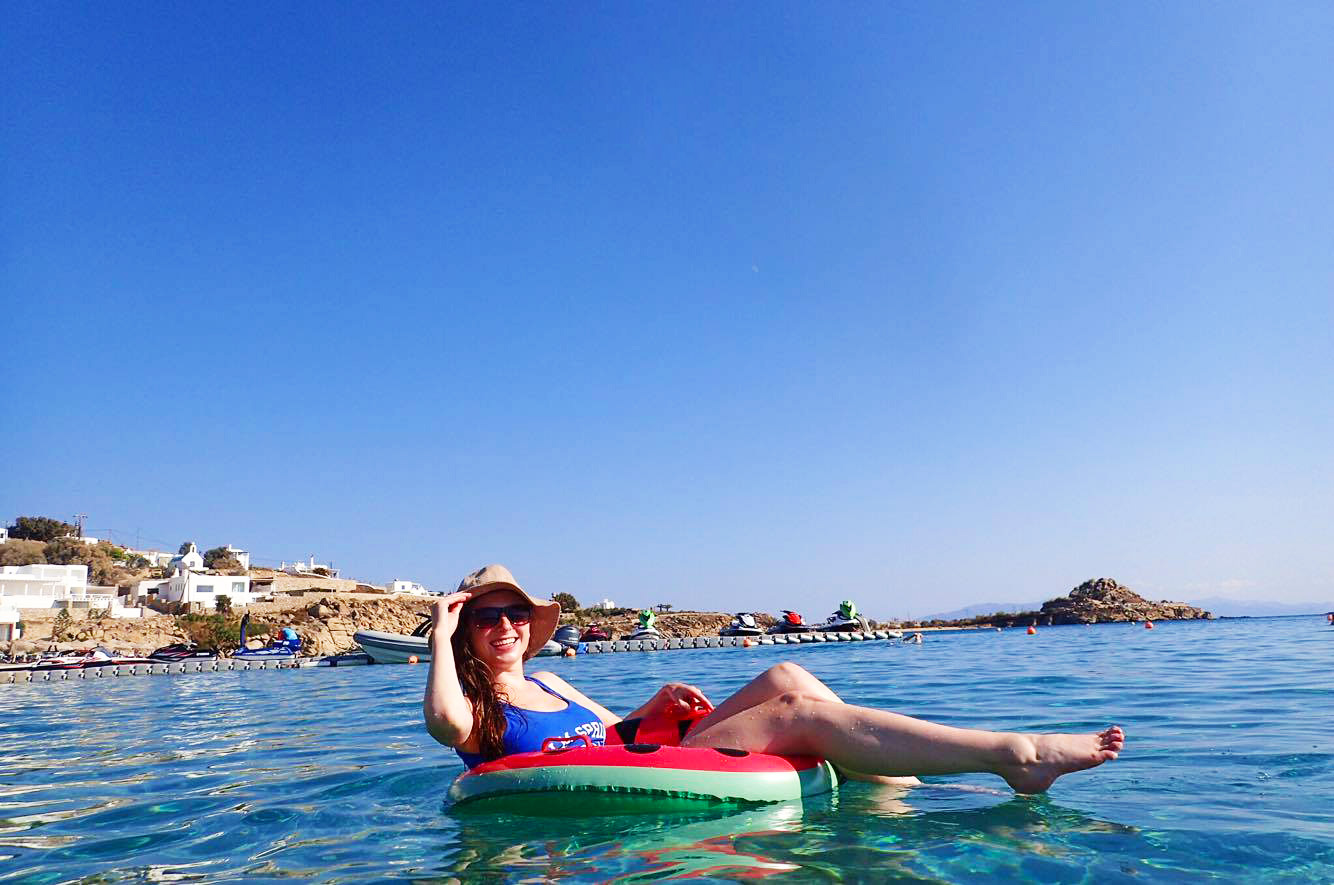 melissa carne in watermelon pool floatie on platis gialos beach on mykonos greece