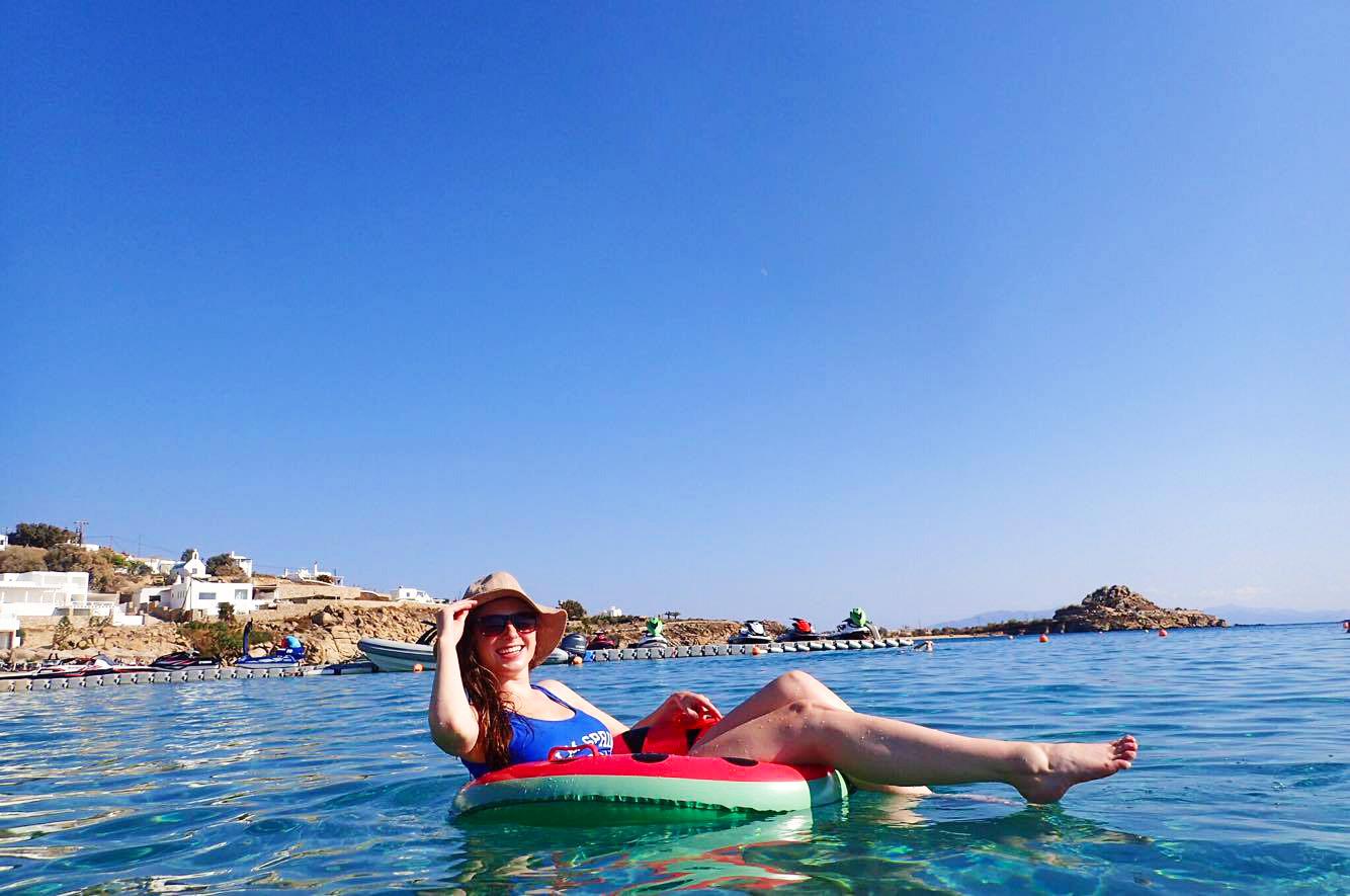 melissa carne in watermelon pool floatie on platis gialos beach on mykonos greece