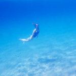 girl underwater snorkel mykonos greece