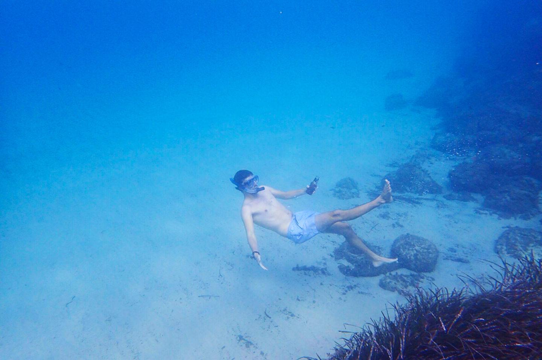 man-snorkelling-underwater