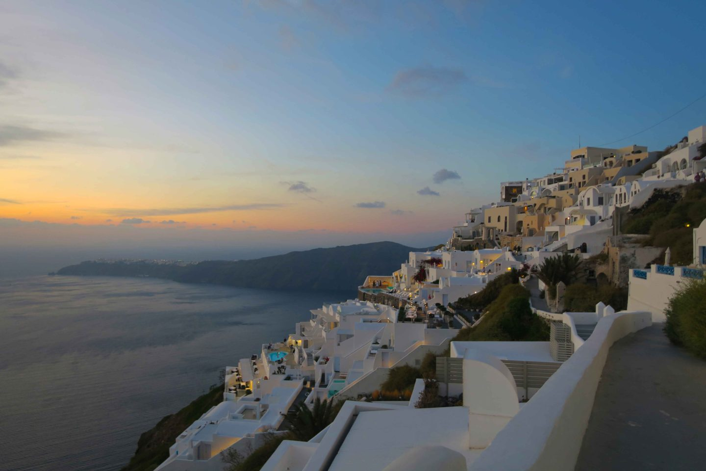 the town of oia in santorini at dusk