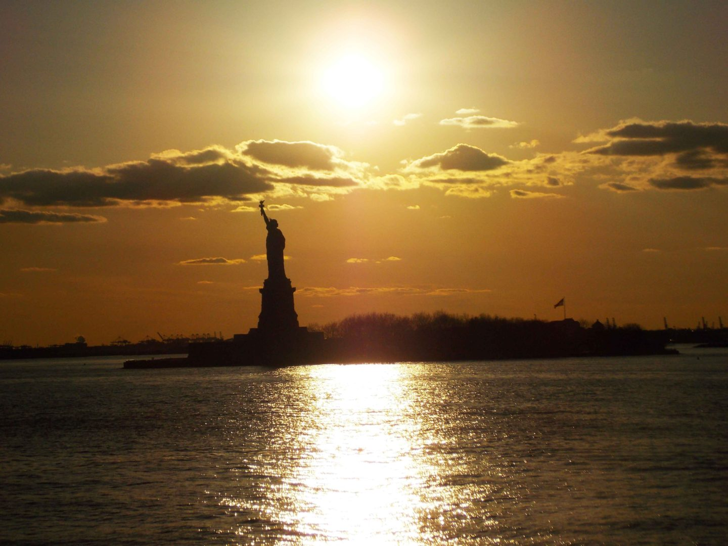 statue of liberty at sunset in new york