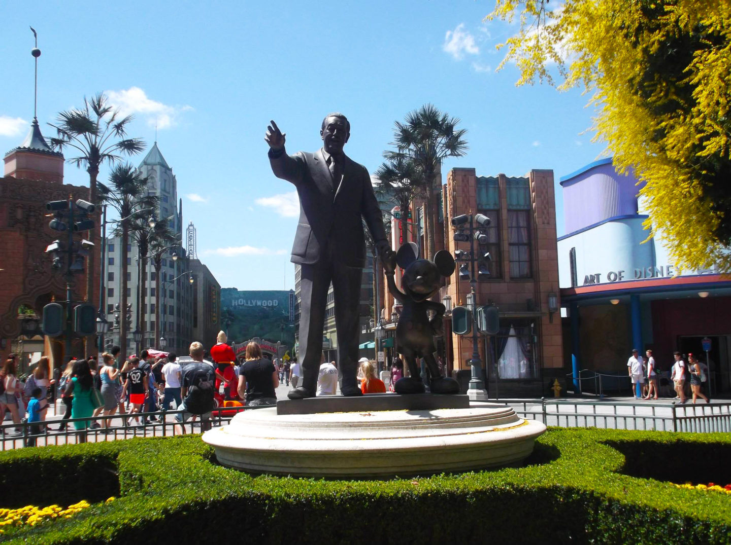 walt disney and mickey mouse statue at disneyland paris