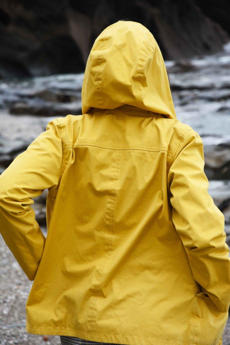 yellow seasalt sea folly jacket on beach in cornwall