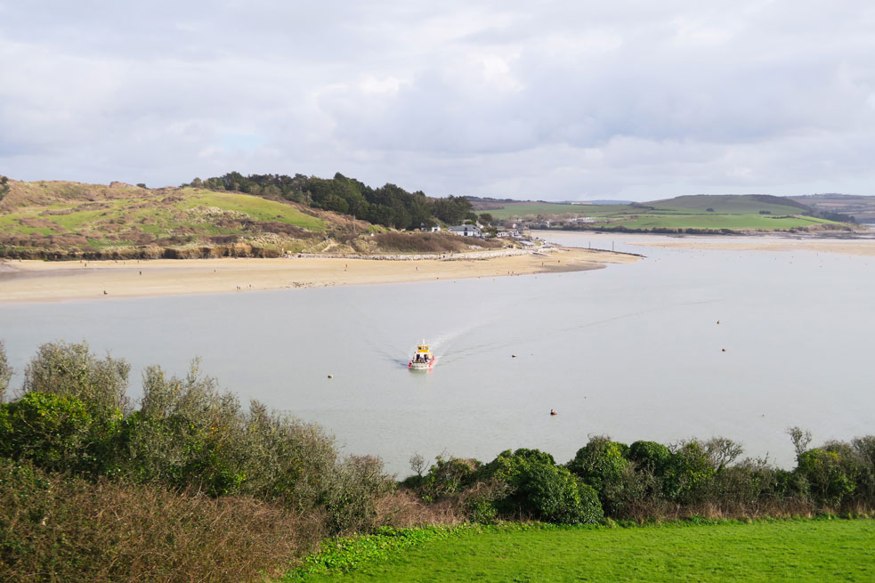 ferry crossing the estuary from rock in cornwall