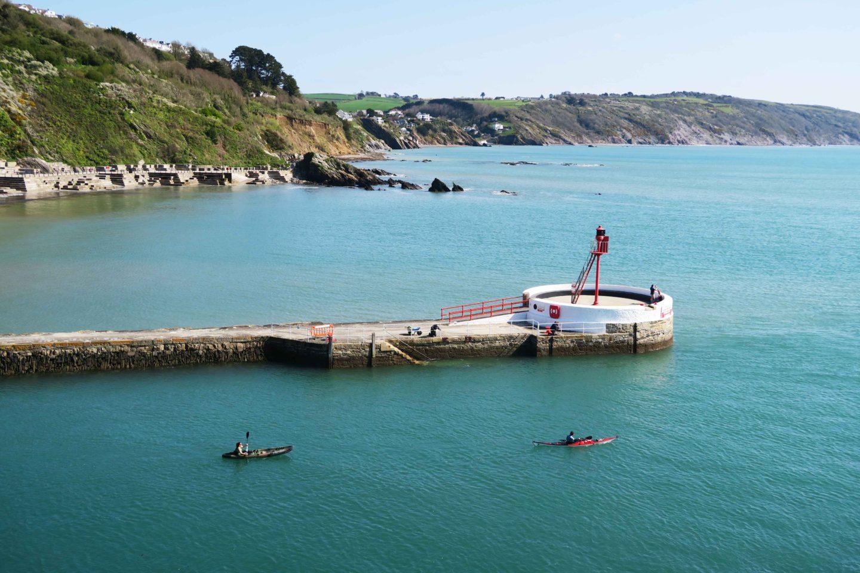 kayakers off banjo pier in looe, cornwall