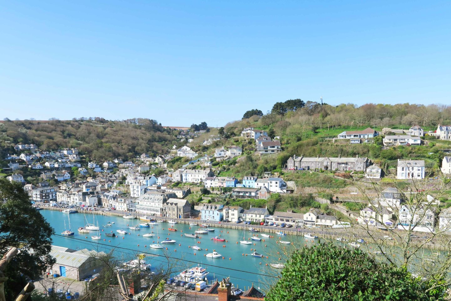 view of looe river with the tide in on a sunny day in cornwall