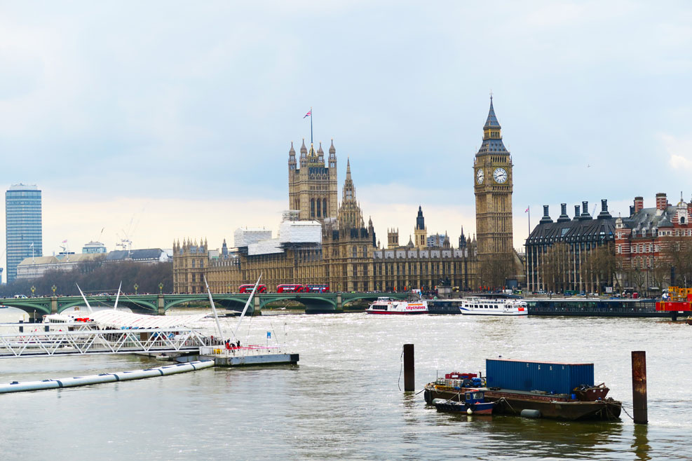 westminster and big ben view from the overside of the river thames in london