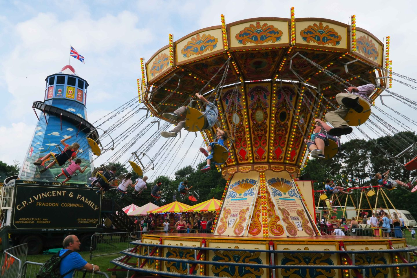 old fashion fairground merry go round and helter skelter