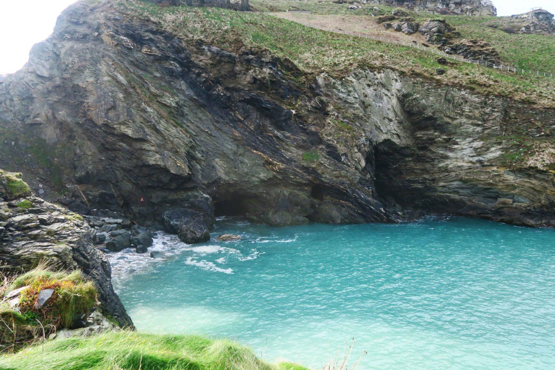 english heritage merlins cave tintagel cornwall