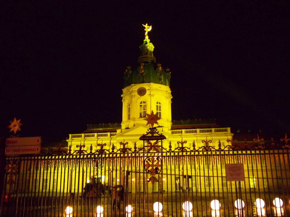 berlin palace lit up at the german christmas markets