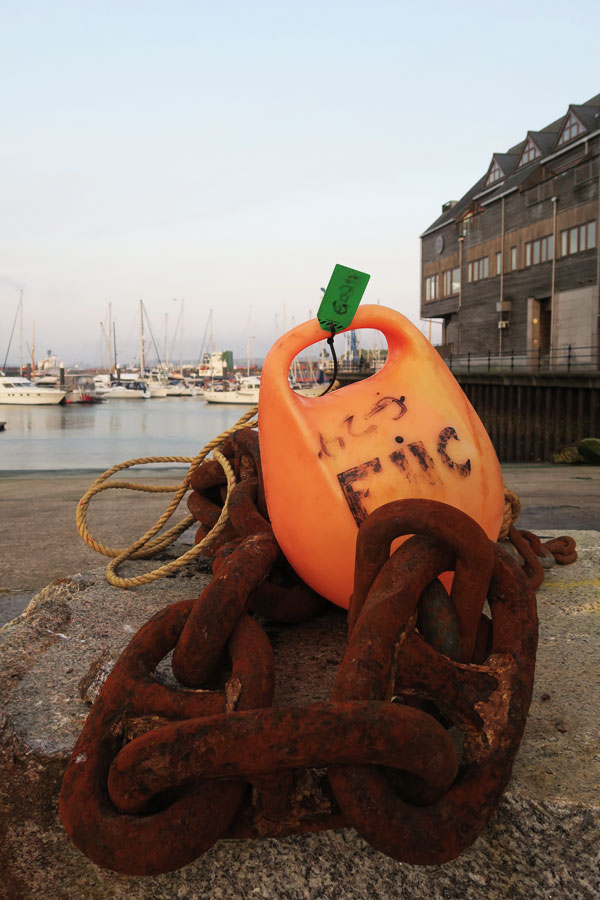 rust chain and buoy in falmouth harbour