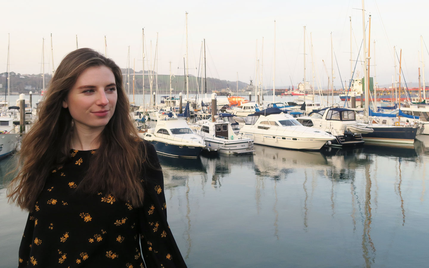 melissa carne standing in front of boats in falmouth harbour