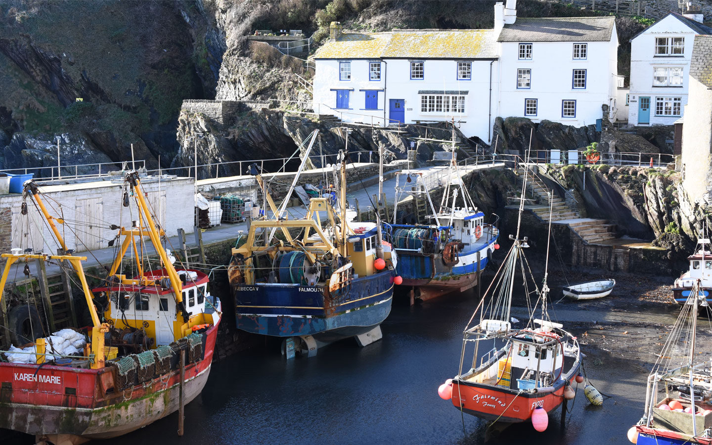 polperro harbour with fishing boats in