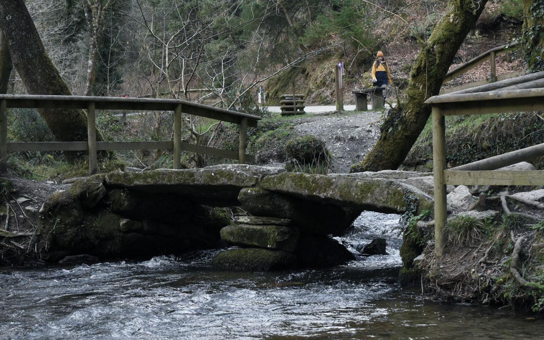 old stone bridge at cardinham woods in cornwall