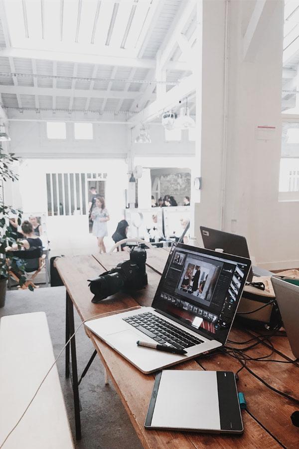 mac book open in a studio