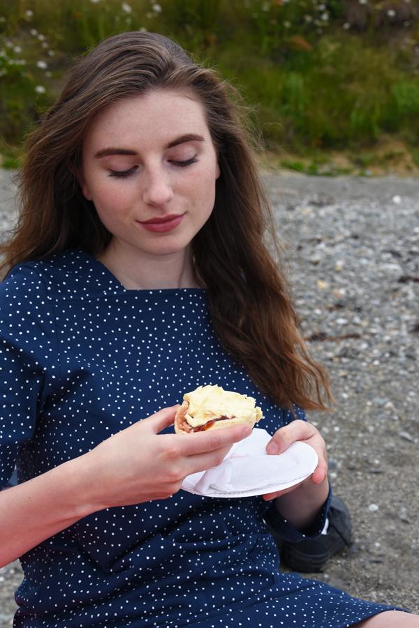 melissa carne eating scone in lighthouse clothing blue polka dot dress