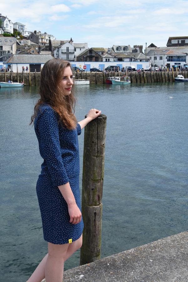 melissa carne wearing blue polka dot dress from lighthouse clothing