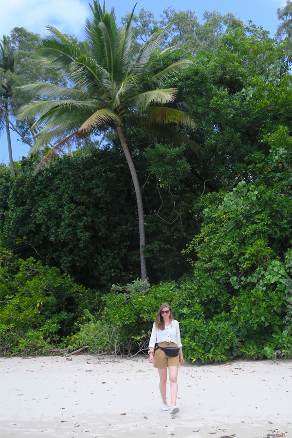 melissa carne on beach with palm tree at daintree rainforest in cape tribulation in australia