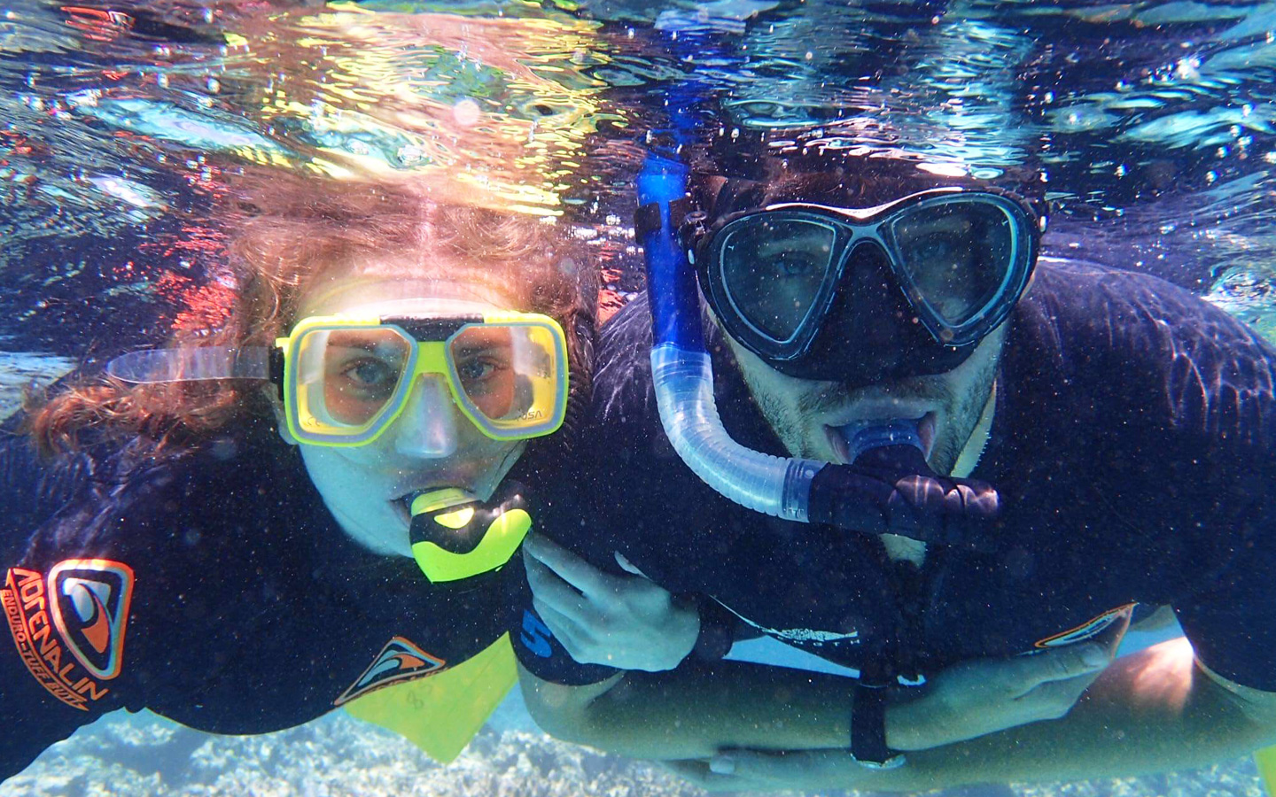 melissa carne and sam gill snorkelling in the great barrier reef in australia