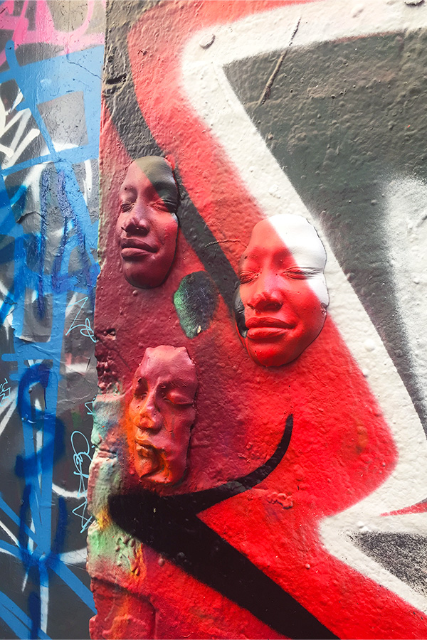 faces on graffiti wall in melbourne in australia