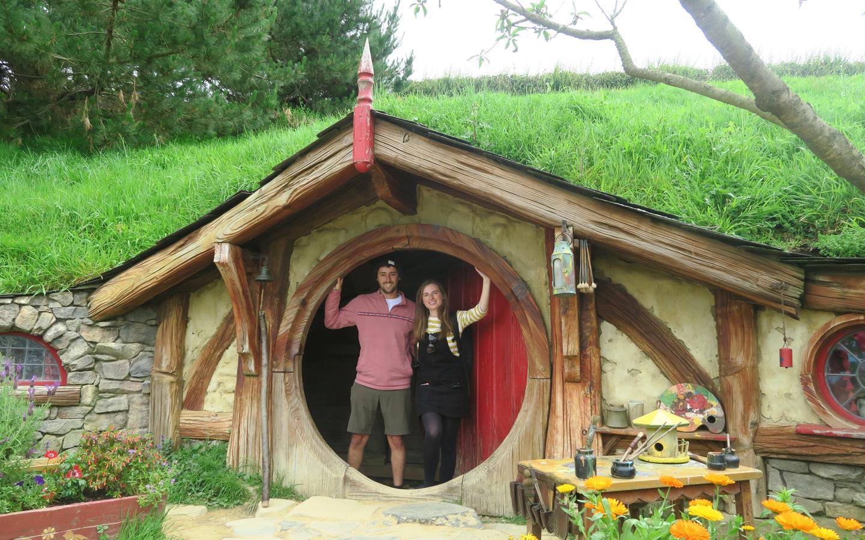 melissa carne and sam gill in hobbit house door in hobbiton