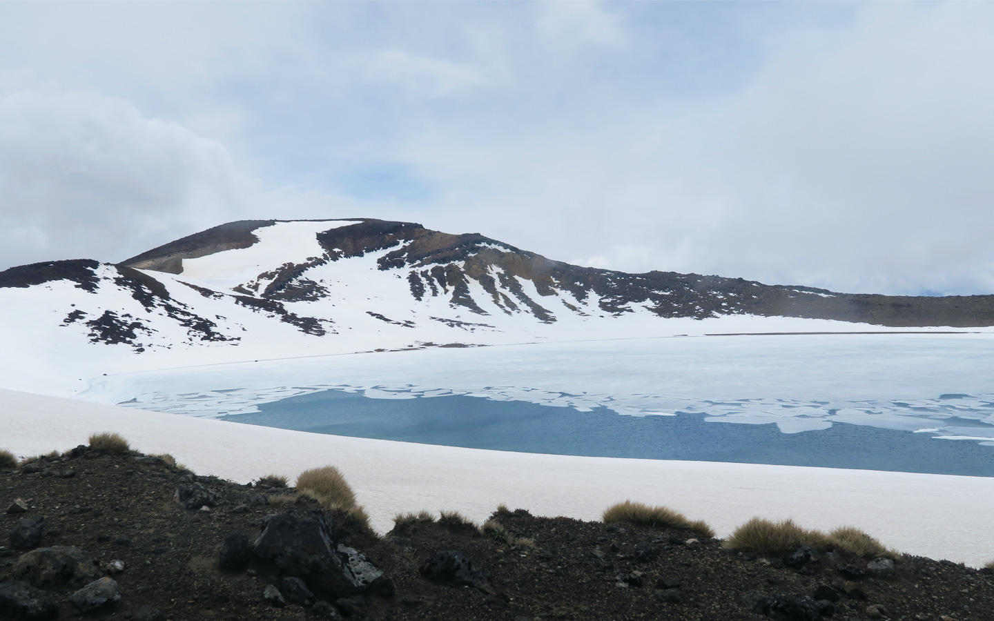 frozen lake with mountain up mount tongariro in new zealand