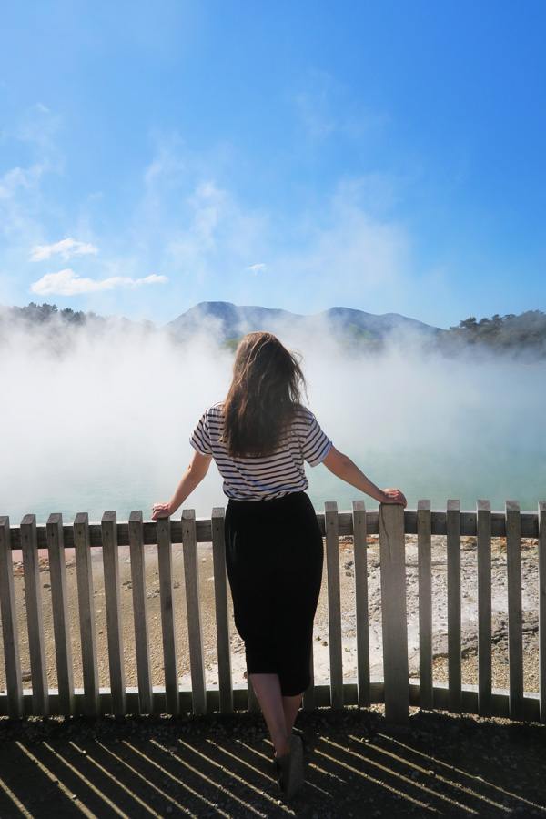 melissa carne in stripe top looking at steamy lake