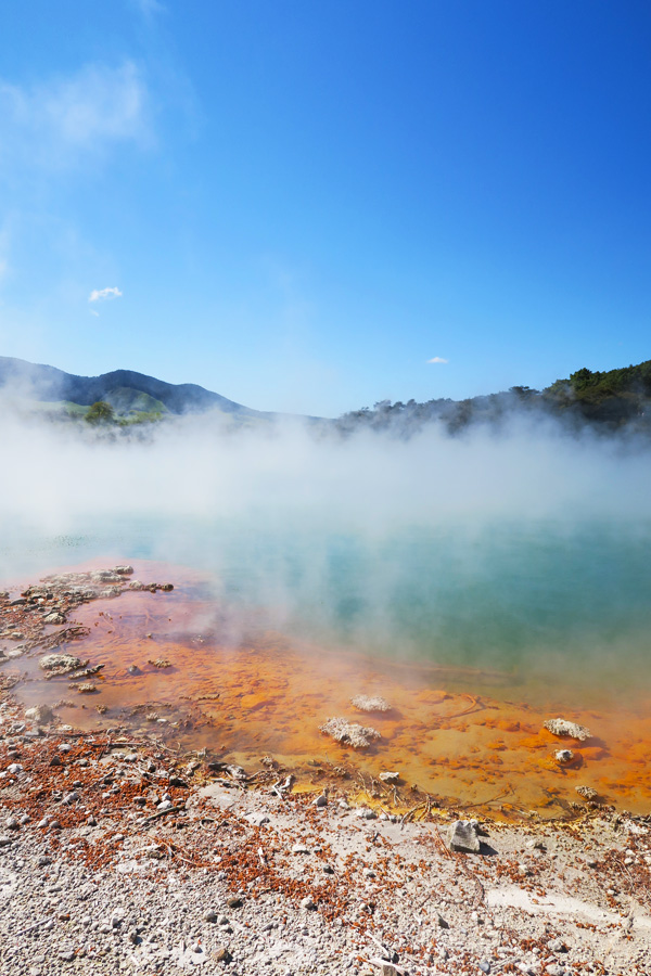 orange and blue geothermal area in waiotapu in new zealand
