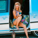 charlotte lodey from the palm tree club sitting in a van